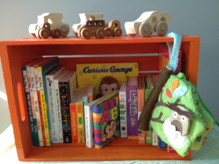 books. baby. nursery. crate. toy trucks.