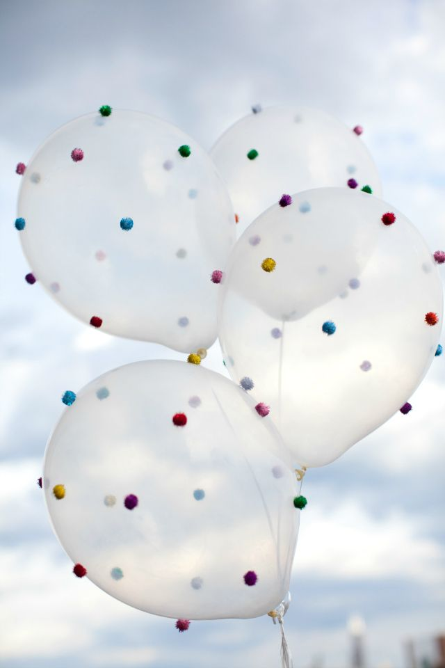 Cute pom-pon balloon idea! Although I detest helium balloons (not a good use of a rapidly diminishing non-renewable natural resource - google it!), I think this would look pretty spectacular on regular balloons too! :)