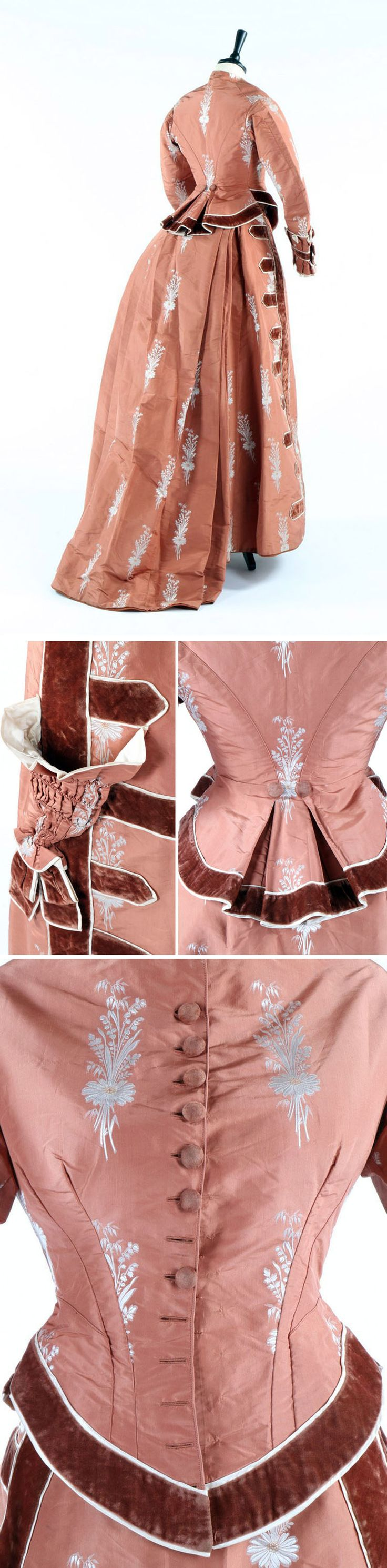 Dress ca. 1876, possibly modified in early 1880s. Silk taffeta in cinnamon brocade figured with ivory floral sprays. Bodice has low curved basque in front and broad pleats in back, is edged in ruffled pleats & lined in ivory satin. Borders trimmed with velvet ribbon. Separate skirt has ruched & pleated conical pocket in front lined in ivory. Kerry Taylor Auctions