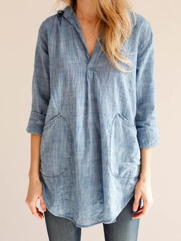 EASY AND EFFORTLESS TETON TUNIC BY CP SHADES. OPEN V-NECKLINE. SIDE PATCH POCKETS. RELAXED FIT. Color- Chambray FABRIC- 100% cotton Made in the USA