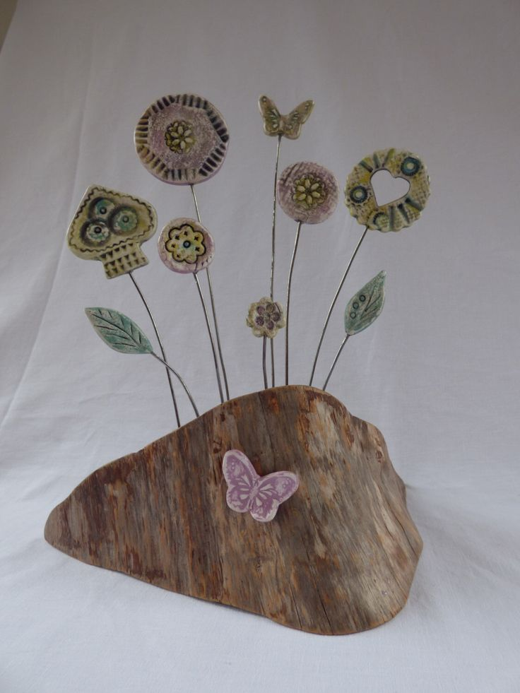Clay flower display mounted on New Forest wood by SharwoodDecor on Etsy https://www.etsy.com/uk/listing/456385188/clay-flower-display-mounted-on-new