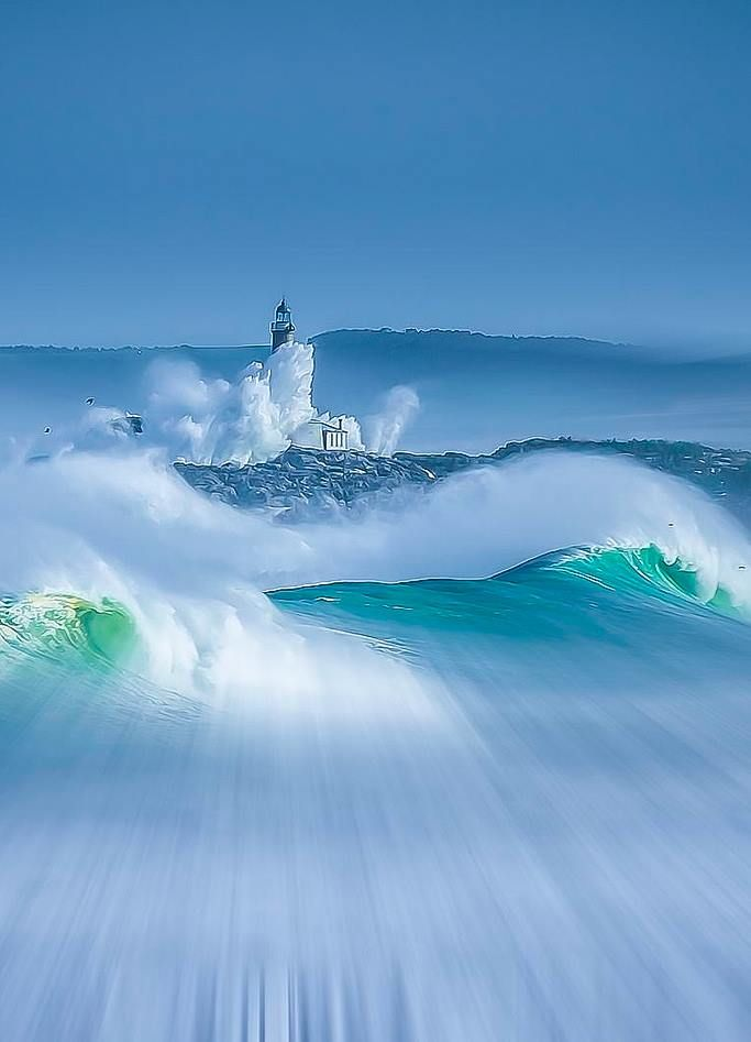 Costa de #Cantabria. Waves hitting against the coast and a lighthouse. #Spain by Max Decker.