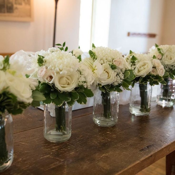 Bridesmaid bouquets all lined up and ready to go.  Commercial mums, peonies and roses with ornithogalum. Thanks to Kelly LeMay for the image #dandieandie #dandieandiefloral #mississaugaflorist #torontoflorist #enochturnerschoolhouse