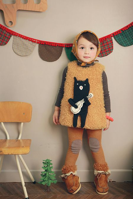 I don't think she could get any cuter if she TRIED! (with mittens and a coat, please)
