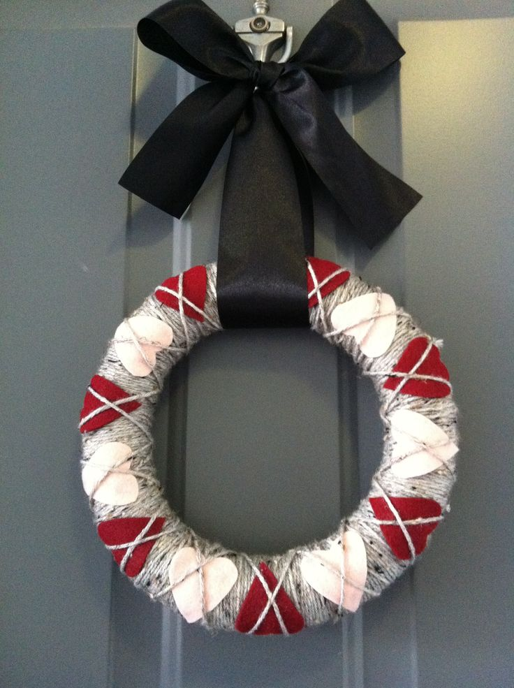 Cheap and easy to make Valentines Day Wreath! Wreath foam, grey yarn, red and pink felt hearts. Viola!