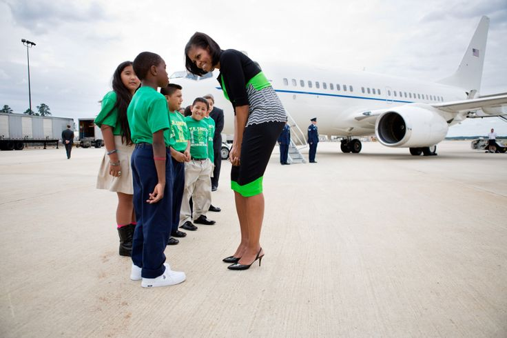 First Lady Michelle Obama greets students from the East Durham Children's Initiative upon arrival at Raleigh-Durham Airport in Morrisville, N.C., Sept. 19, 2012 (Photo by Sonya N. Hebert)