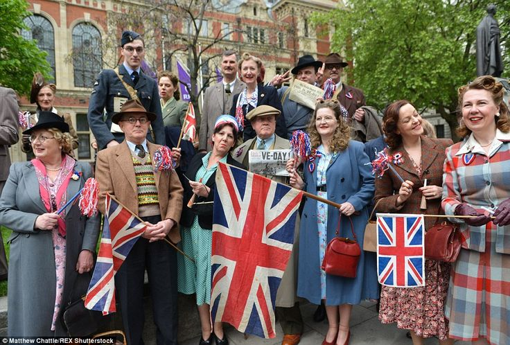 Party like it's 1945: Dressed in wartime costumes and proudly waving Union flags, patrioti...