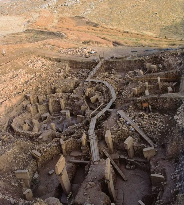 Göbekli Tepe is a Neolithic (stone-age) hilltop sanctuary erected at the top of a mountain ridge in southeastern Anatolia, some 15 kilometers (9 mi) northeast of the town of Şanlıurfa.The site was most likely erected by hunter-gatherers in the 10th millennium BCE.