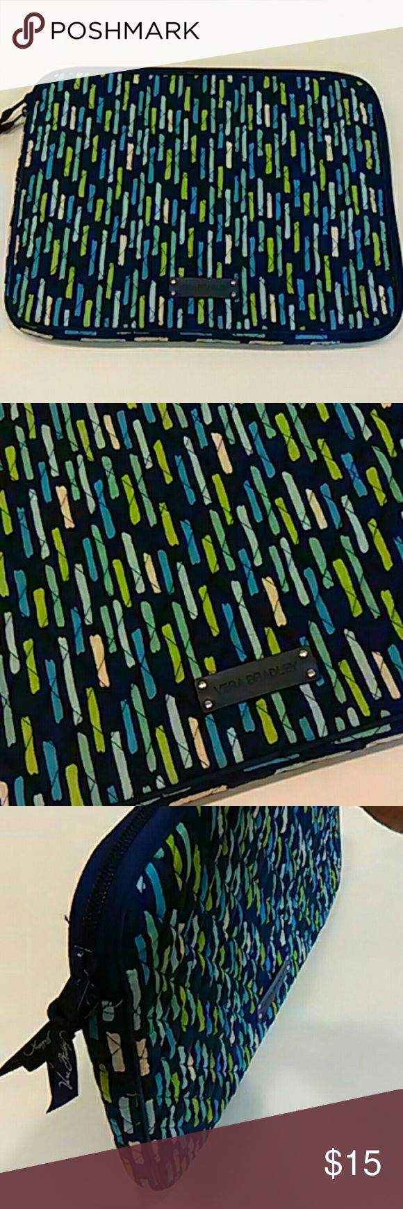Laptop case Vera Bradley Katalina Showers This is a very nice padded laptop carrying case in Katalina Showers, in shades of blues and greens.  The zipper runs from the top left of the bag, across the top, and all the way down the right side.  Inside, there is a slip pocket with a flap that closes with Velcro.  There is evidence that a laptop rubbed against the pocket inside, but there is no other sign of use.  I have matching backpacks and totes in the coordinating Katalina Blues floral…