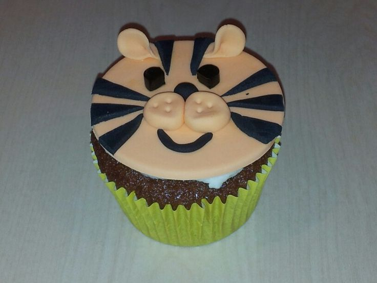Tiger cupcake for SPCA cupcake day 2013. Honey cupcake, vanilla butter cream, fondant tiger face.