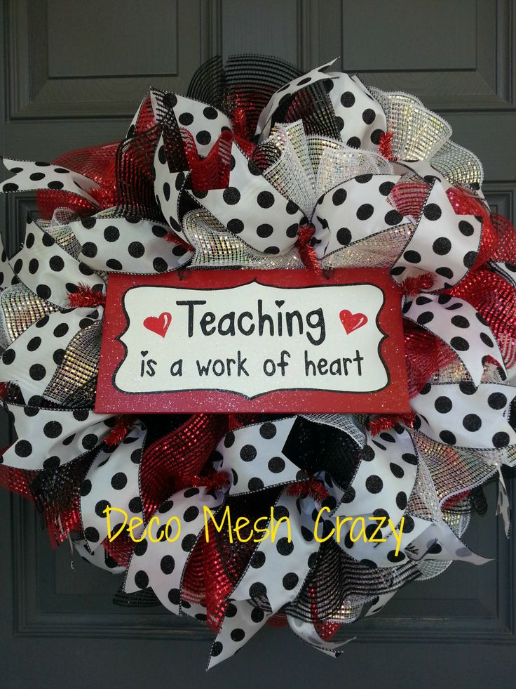 """This wreath is perfect for a teacher of any kind or would be a wonderful gift for that special teacher.  Read on for additional details.  This wreath...  -Features 3 different types of premium foiled deco mesh- black, red, and white- in a """"ruffled"""" style.  -Also features white ribbon with g..."""