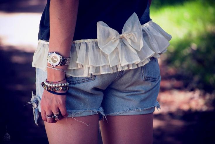 ruffles & bow sewn on to lengthen a T-shirt.... great idea!! ~ http://gabbiadorata.files.wordpress.com/2012/02/dsc_0036.jpg