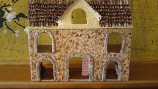 DIY dollhouse... under construction. It is made out of a shoe box