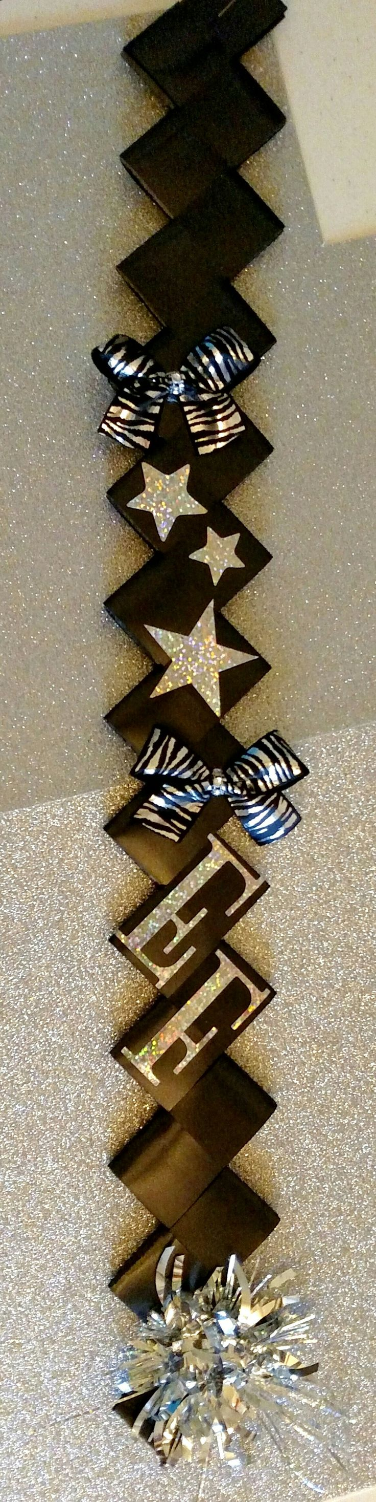 Black diamond braid for homecoming mum. Silver stickers, zebra print bows and tinsel. Designed by Crafty bug
