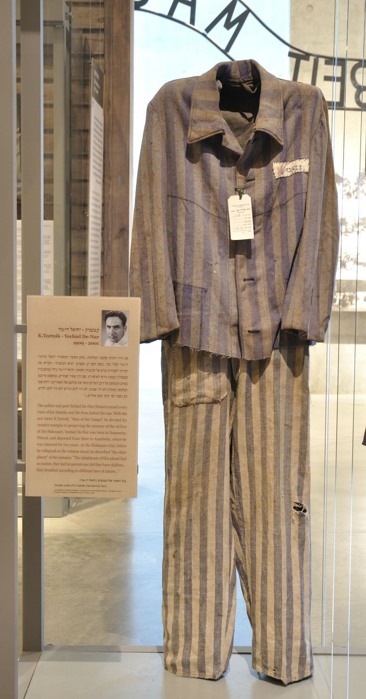 "Prison shirt & trousers that belonged to Auschwitz inmate Yechiel Feiner (Dinur) whose literary persona was ""Kazetnik""– ""a man of the camps"" who dedicated his life to telling the story of the victims. In his testimony at the Eichmann trial, before he collapsed on the stand, he described Auschwitz as ""a different planet""…"" they did not live nor die there according to the laws of the world as we know it. Their name was a number…"" Loaned by the Prime Minister's Office-Israel State Archives…"