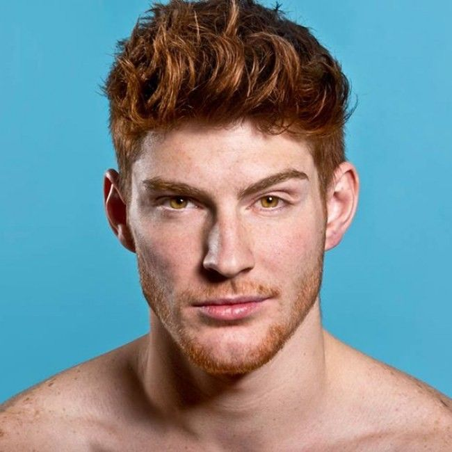 Jarlath (minus the scales and white eye) but like he's got the red stick-uppy hair and brown eyes and looks sarcastic as shit