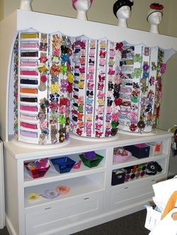 Hair Bow Storage.  We need something like this at our house.  That is my new weakness.  HAIR BOWS!!!!!