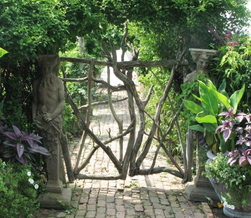 Charlie Baker designed this, and it makes me think of Mrs. Mc Phearson, and makes me want to go to her house years and years from now for a garden party.      : )   I know she'll have a garden like this...