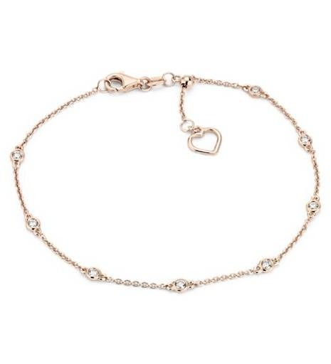 Eight petite bezel-set diamonds are stationed around a 14k rose gold cable chain adorned with a delicate heart accent.