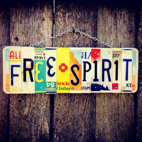 Free spirit recycled License plate sign Hangs on chain. Colors and states may vary.