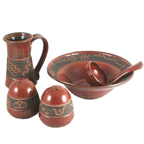 Petroglyph Kitchen Pottery - Functional pottery handmade in New Mexico. Prehistoric designs adorn hand-thrown earthenware. Centuries before Europeans arrived, Native Americans etched images and markings on boulders, cliffs, and outcroppings throughout the Southwest. Our Petroglyph Pottery displays some of that timeless art on functional pieces of handmade earthenware.  Choose from Salsa Bowl with Ladle, Salt and Pepper Shakers, Coffee Mug, Spoonrest, and Pencil/Pen Holder.