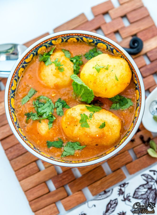 Indian style baby potatoes cooked in a spiced tomato yogurt curry. #vegetarian #indian #curry Find the recipe on www.cookwithmanali.com
