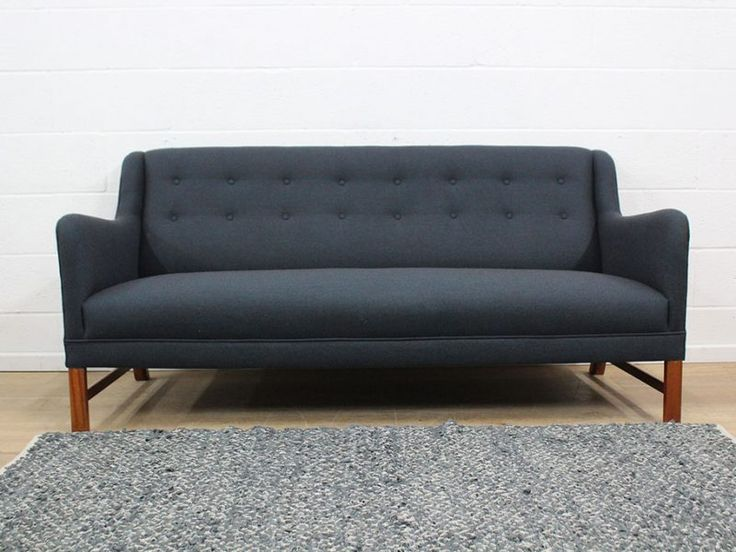 An Elegant Four Seater Mid 20thc 60s Scandinavian Sofa With Angled Frame And Tapered Legs