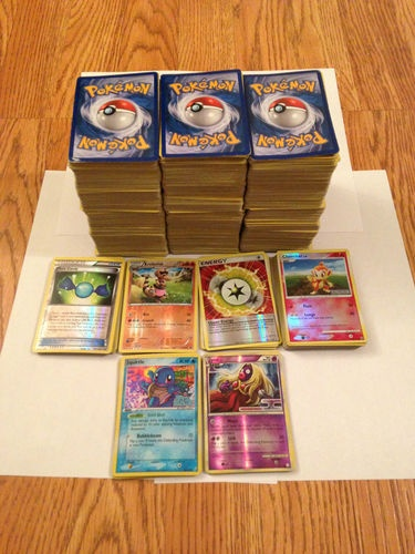 Lot of 100 Random Pokemon Cards. To give kids as prizes.