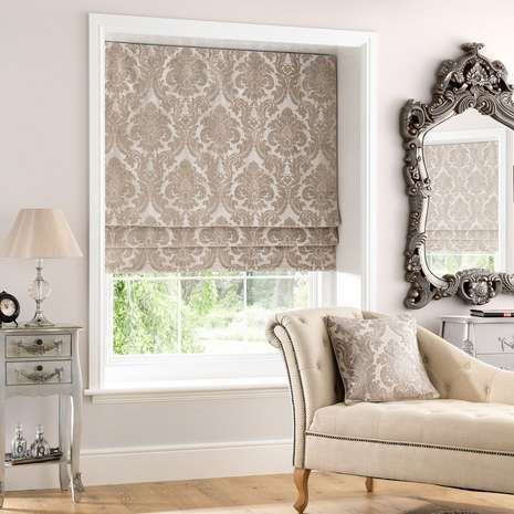 Elegantly embroidered with bold damask patterns in a warm natural tone, this roman blind is lined to retain warmth and finished with an elegant subtle sheen. Available in a selection of sizes.