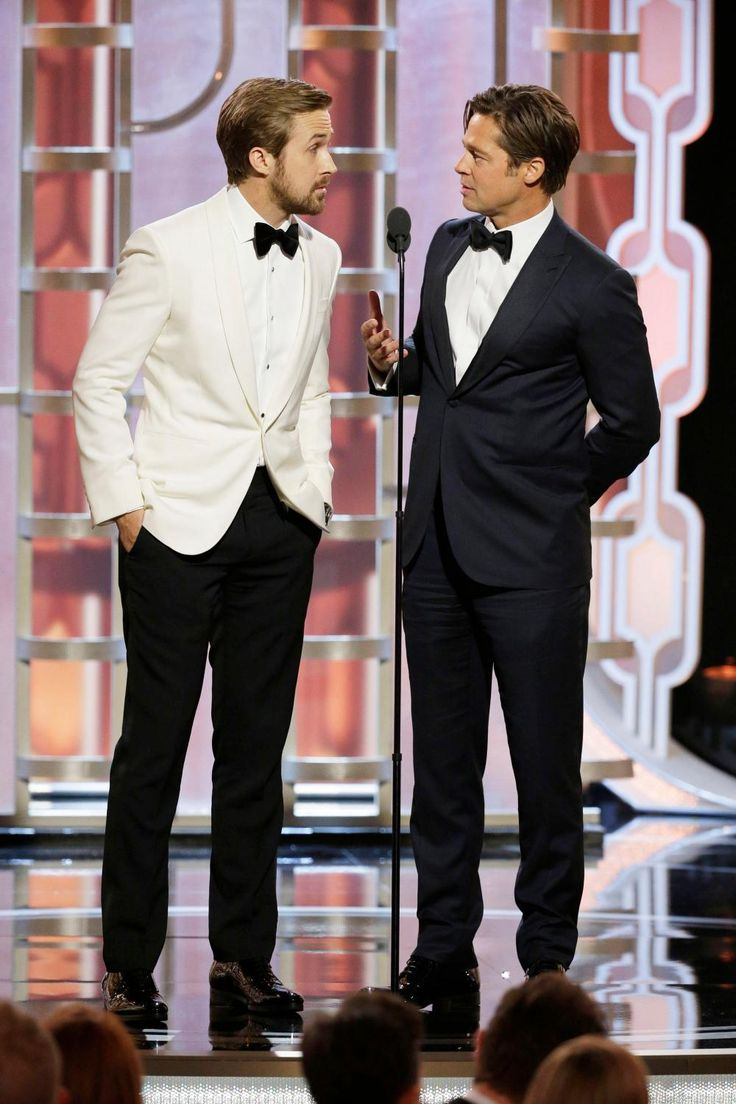 1. Ryan Gosling: Finally, one Ryan Thomas Gosling straight-up stole the show in a white tuxedo jacket reminiscent of the 1940s and 1950s. There's no man who could've pulled off this glamorous style quite as successfully as Gosling, and we salute him for going vintage. (Oh, and Brad Pitt is in this picture, too.) Photo: Paul Drinkwater/NBCUniversal via Getty Images.