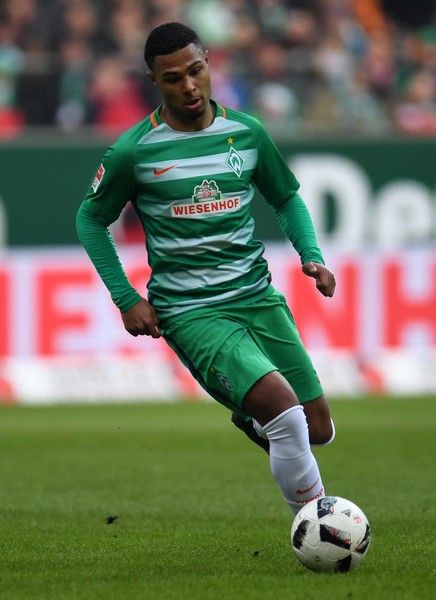 Bremen's midfielder Serge Gnabry plays the ball during the German first division Bundesliga football match of Werder Bremen vs FC Bayern Munich in Bremen , nothern Germany, on January 28, 2017. / AFP / PATRIK STOLLARZ / RESTRICTIONS: DURING MATCH TIME: DFL RULES TO LIMIT THE ONLINE USAGE TO 15 PICTURES PER MATCH AND FORBID IMAGE SEQUENCES TO SIMULATE VIDEO. == RESTRICTED TO EDITORIAL USE == FOR FURTHER QUERIES PLEASE CONTACT DFL DIRECTLY AT + 49 69 650050.