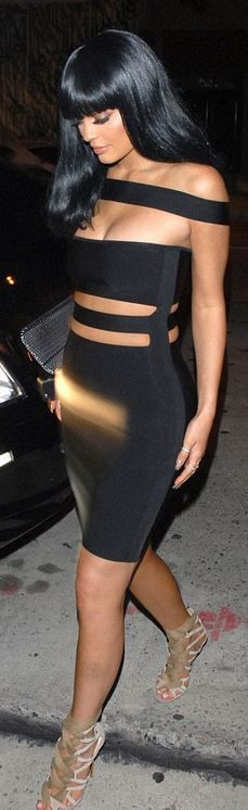 Who made  Kylie Jenner's gold jewelry, lace up sandals, and black cut out dress?