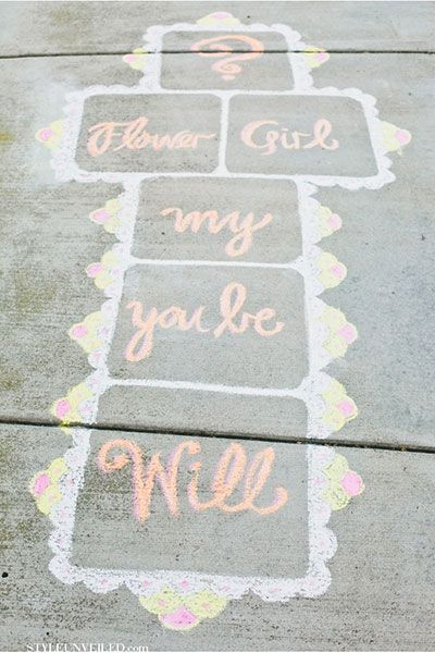 Spend hours decorating the sidewalk outside your potential flower girl's house as a special way to invite her to be in your wedding.  Toddlers especially love this method since they neither read nor play hopscotch.