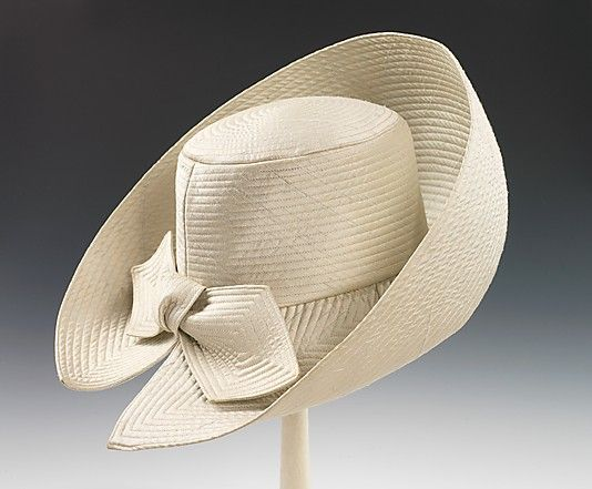 Hat | Halston (American, 1932-1990) | Date: ca. 1965 | Material: silk | Beginning his career as a milliner, Halston later crossed over to ready-to-wear, promoting minimal design | The hat featured here is a wonderful example of Halston's early milinery work. The shape of the hat is very inventive as well as dramatic with the upturned brim | The Metropolitan Museum of Art, New York