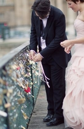 There is a bridge in Paris where you can put a lock on the bridge as a symbol of your marriage. They throw the key in the water after they lock it. Cool!!!