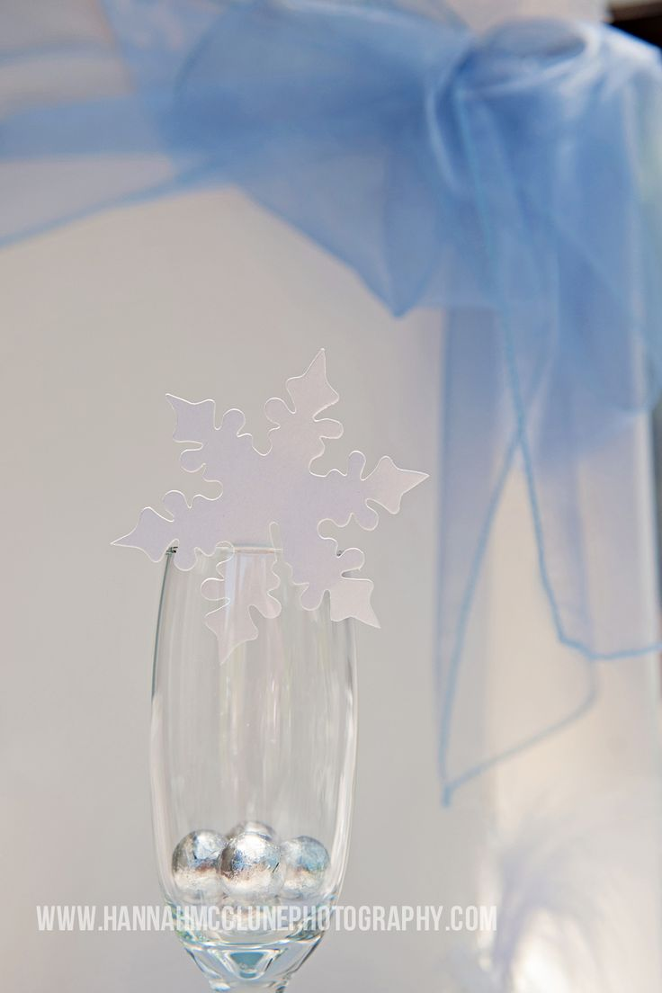 Snowflake glass decoration. Great for a Christmas winter wonderland wedding. These can also be used to write guests names on as a place setting or to put on a Christmas tree by www.fuschiadesigns.co.uk.