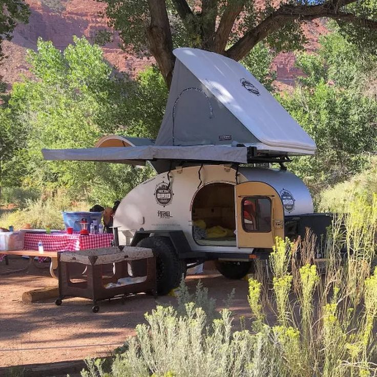 Teardrop Trailer With A Custom Roof Rack And Rooftop Tent