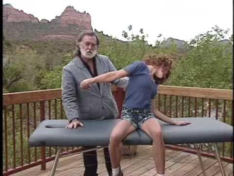 a younger John explaining Myofascial Unwinding, a fantastic self treatment technique.