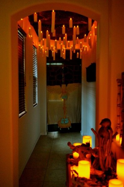 Floating candles...toilet paper/paper towel tubes suspended with led lights...