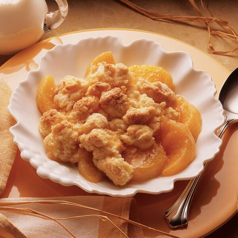 Peach cobbler made easy with peach pie filling and cobbler topping.