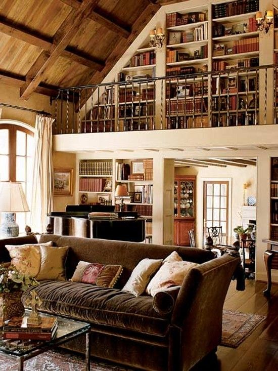 Everything about this room says home to me: Vaulted wood ceiling, hardwood floors, sunshine, warm colors, PIANO, cozy couch for reading, and books, books, books!