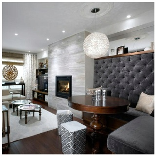 Love this for a basement bar area.....Candice Olson-tufted banquette
