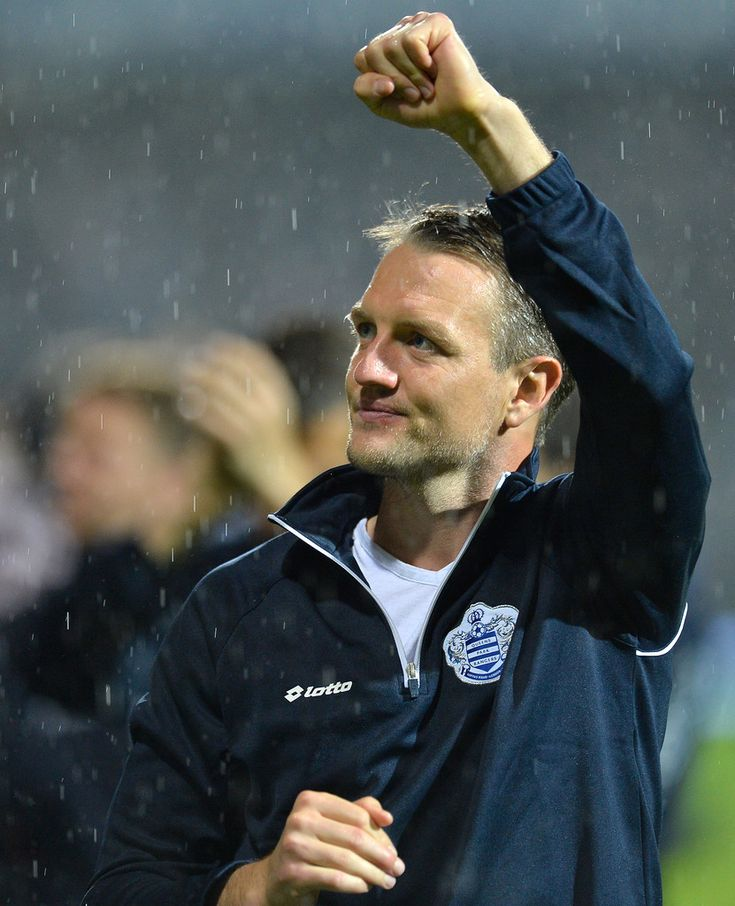 Clint Hill Photos - Clint Hill Of Queens PArk Rangers celebrates after winning the Sky Bet Championship Play Off Semi Final second leg match between Queens Park Rangers and Wigan Athletic at Loftus Road on May 12, 2014 in London, England. - Queens Park Rangers v Wigan Athletic