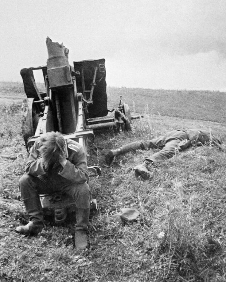 July 1943. A German soldier sitting with his head in his hands by a destroyed…