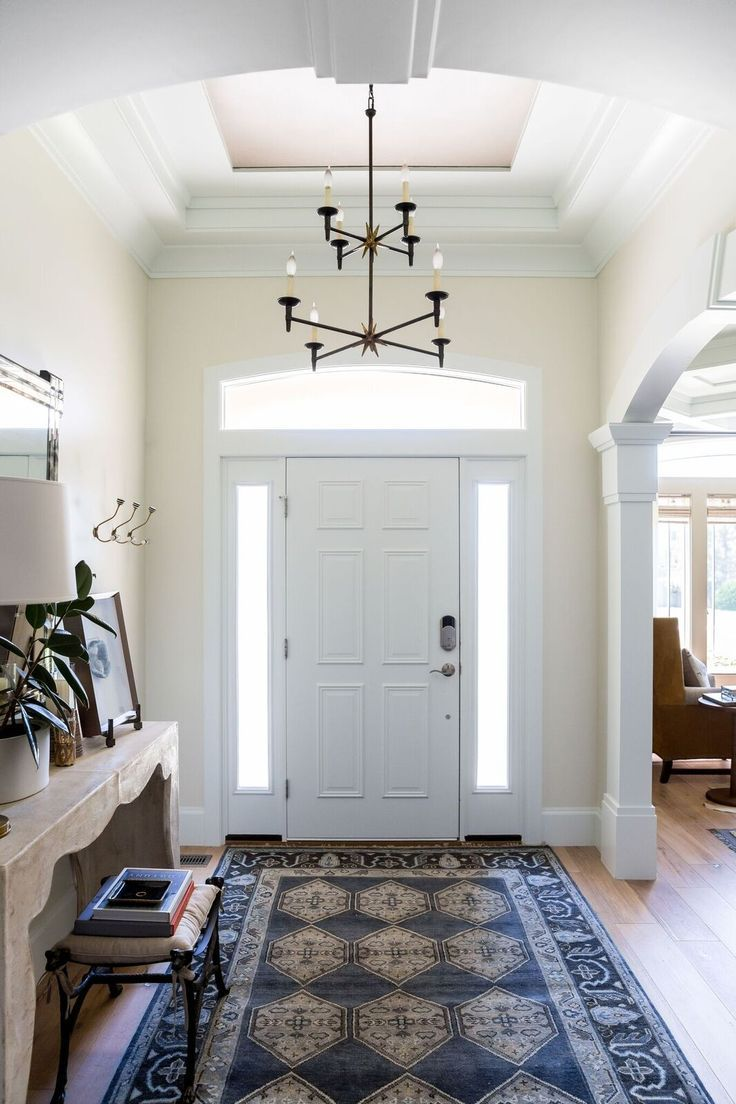 Traditional and timeless finish work in this stunning entryway --with  vaulted ceiling, crown