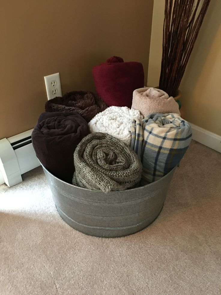 Repurposed ice bucket into a blanket holder