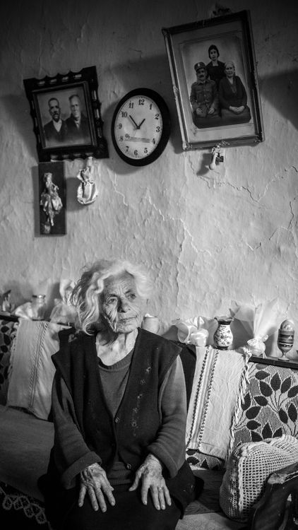 #people #old #older women An old woman sitting in her living room in a small village in crete-Greece, remembering her husband who passed away, and her kids who are living in the city. -- Your Shot. NATIONAL GEOGRAPHIC.