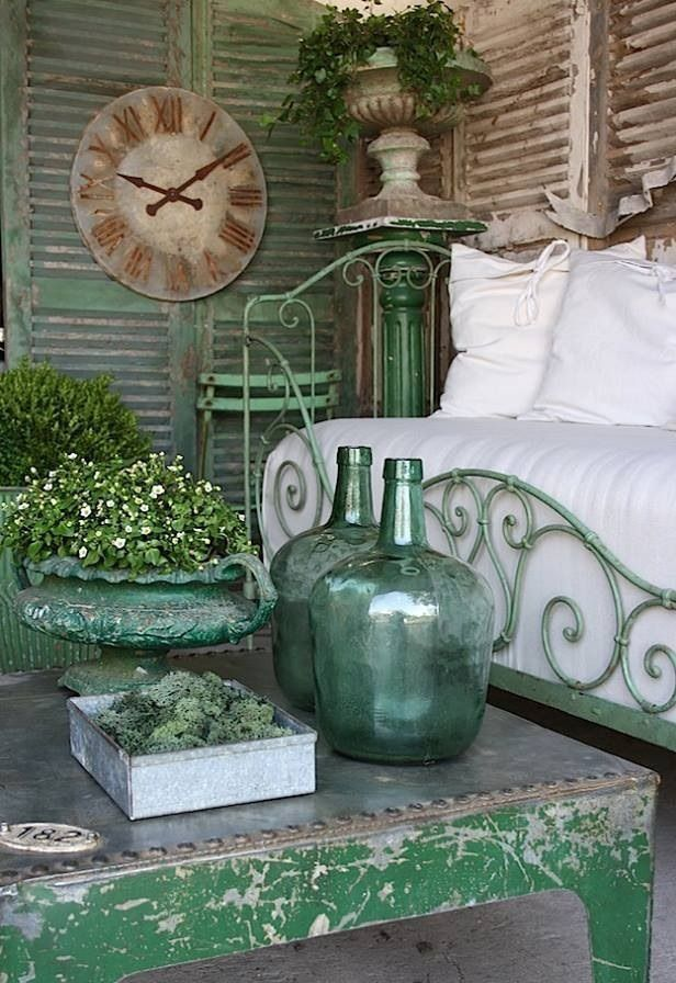Beautiful day bed on a porch with shutters all around!