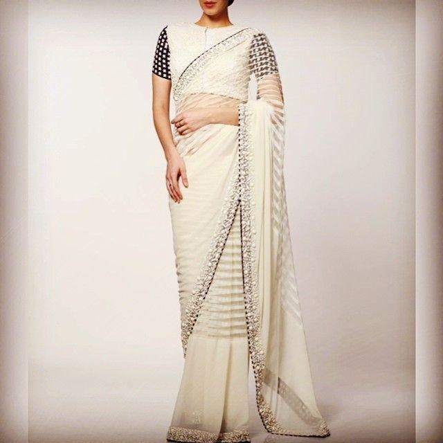 A resplendent white net saree with tone-on-tone stonework borders by @neeta_lulla. #neetalulla #czarinaofindianfashion #online