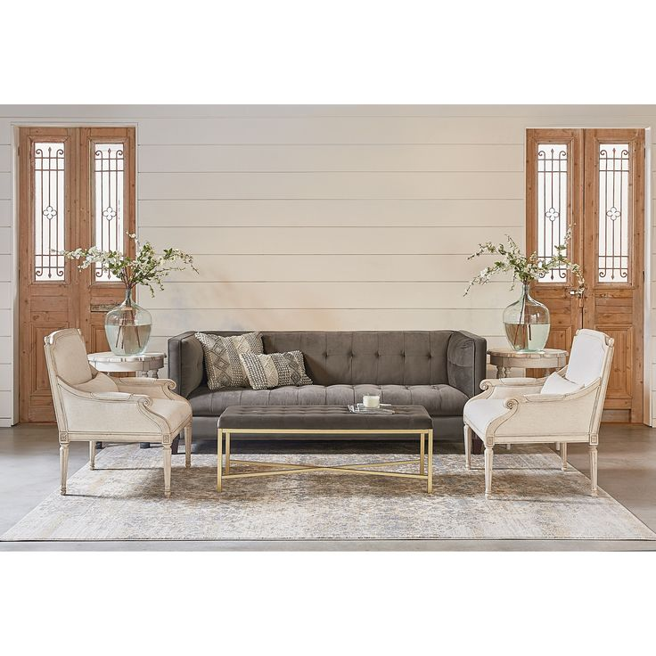 All dressed up with its tailored tuxedo styling, this transitional style sofa is a true eclectic mixer. Joanna chose a deliciously plush Fog color velvet fabric so it's an easy match for most rooms.